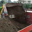 Photo: Excavator loading dumper truck tipper