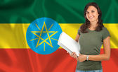 Female student over Ethiopia flag — Stock Photo