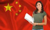 在中国国旗的女大学生 — 图库照片