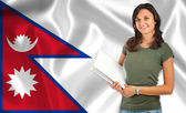 Female student over Nepalese flag — Stock Photo