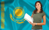 Female student over Kazakh flag — Stock Photo