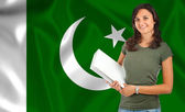 Female student over Pakistani flag — Stockfoto