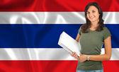 Female student over Thai flag — Stock Photo