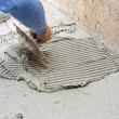 Tiler works with flooring — Stock Photo #42436669