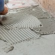 Tiler works with flooring — Stock Photo #42436893