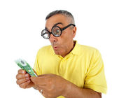 Surprised man with money and WOW expression. — Stock Photo