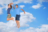 Young couple jumping together — Stock Photo