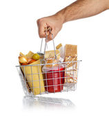 Man takes the shopping basket with food — Stock Photo