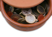 Ceramic pot full of Euro coins — Stock Photo