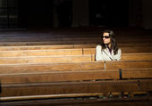 Woman praying in church — Stock Photo