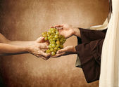 Jesus gives grapes to a beggar — Stock Photo