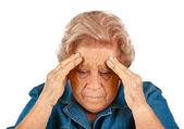 Elderly woman with headaches — Stock Photo