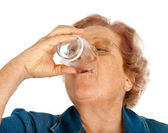 Elderly woman with water glass — Stock Photo