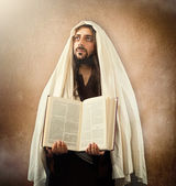Jesus shows the holy bible — Stock Photo