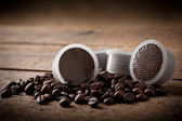 Coffee beans with pods — Stock Photo