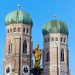 The golden sculpture of Saint Mary and the Church of Our Lady — Stock Photo #45191415