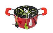Music headphones in red pot — Stock Photo