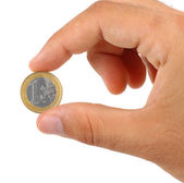 Holding one euro coin — Stock Photo