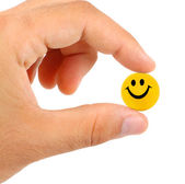 Ball with smile between the fingers — Stock Photo