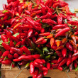 Bunch of red hot chili pepper at market — Stock Photo #51783125