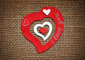 Valentine card with hearts on sackcloth. — Stock Photo