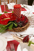 Table with Red roses and candle — Stockfoto