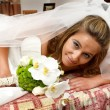 Bride lying in her bed - Stock Photo