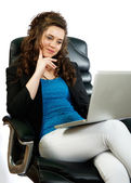 Attractive woman working on laptop — Stock Photo