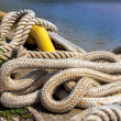 Old boating rope lying on pier — Stock Photo
