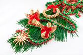 Christmas decorations on pine twig on a white background — Stock Photo