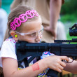 Stock Photo: Single girl shooting .22LR tactical gun with sniper scpoe on a