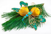 Dragonfly Christmas decoration and two mandarins on pine twig on — Stock Photo