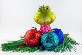 Frog Christmas decoration with three chocolate balls on pine twi — Stock Photo