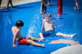 Two boy having fun at a splash pad — Stock Photo