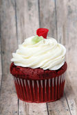 Red Velvet cupcake with rose on top — Stock Photo