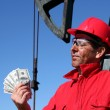 Oil Worker With Dirty Face Holding US Dollar Bills — Stock Photo #18011395