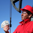 Oil Worker With Dirty Face Holding US Dollar Bills — Stock Photo