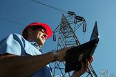 Electrical Engineer Under High Voltage Tower — Stock Photo
