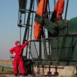 Pump Jack and Oil Worker — Stock Video