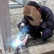 Stock Video: Construction Worker Welding