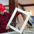 Stock Video: Worker Measuring Window Frame