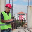 Building Inspector at Construction Site — Stock Video