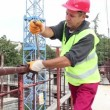 Stock Video: Construction Worker With Ratchet Wrench in Action