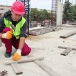 Stock Video: Manual Worker Using Hammer at Construction Site