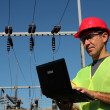 Stock Photo: Engineer Using Laptop at Electrical Substation.