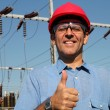 Stock Photo: Successful Engineer in Red Helmet Showing Ok Sign.