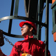 Stock Photo: Oil Industry Worker Using Chain Winch.