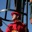 Oil Industry Worker Using Chain Winch. — Stock Photo #40518781