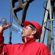 Stock Photo: Thirsty Oil Industry Worker.