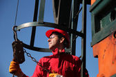 Oil Industry Worker Using Chain Winch. — Stock Photo